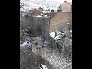 "The view from our Sarajevo apartment in March 1998 after ""Grandmother's Breath"" had dumped a bit of snow on the city."