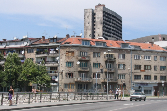 This is the bridge in Sarajevo where a tragic real-life love story happened in 1993.  I took this photo in 2005.  At that time only a small bow and dried flower bouquet marked the incident.