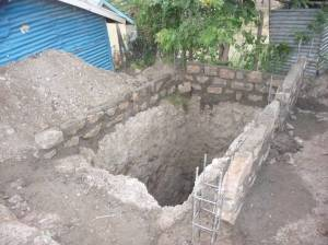 In Africa latrines are hand dug, often to a depth of 40 feet, through sand, gravel and stone.  A long labour-intensive job.