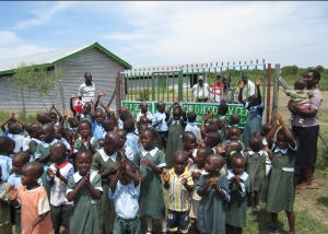 Children outside the gate of the S.P. Geddes Early Childhood Development Centre in Kenya