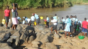 Students at the Nyandema Secondary School have to walk about 5km every day to get water... and then it is from this muddy river.  CanAssist will fund four rainwater catchment tanks at the school to provide a clean accessible water supply.