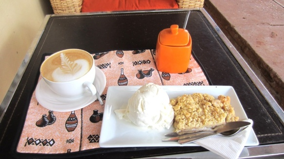 Cappuccino, warm apple and Passionfruit crumble with  ice cream - $6 at Flavours on the Main Street of Jinja, Uganda.