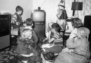 Halloween party 1953. I am on the chair by the TV.