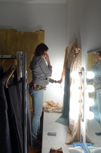 Director Leigh Ann Bellamy contemplating how to dress this set.