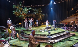 The bare thrust stage at the Festival Theatre converted to a summer garden party for Midsummer Night's Dream.  As the audience came in, actors as partygoers, mingled and chatted with them.