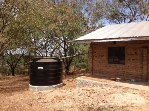 After a good rain, this tank will be full and provide clean drinking water at the Kamser school for several weeks.