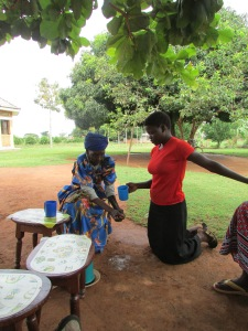 Neighbour helps Josephine wash her hands before we have afternoon tea.